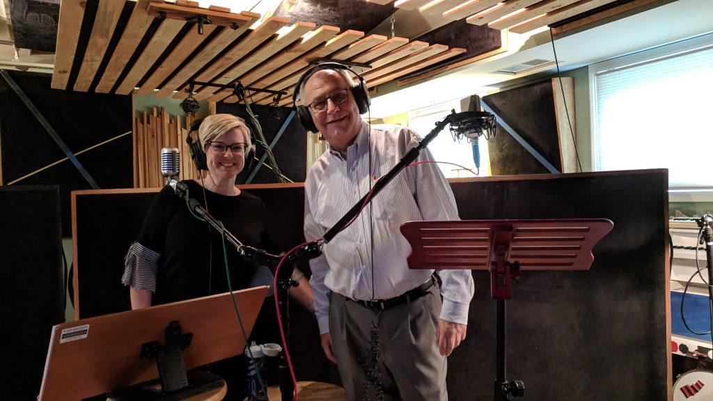 John Cook and Mary Emily Wood prepare in the podcast studio to record an episode of The Patient Experience.